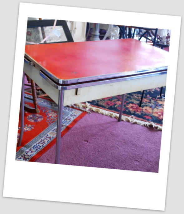 A throwback from the 50's, this authentic retro formica kitchen table has two side leaves that pop up for extra room!