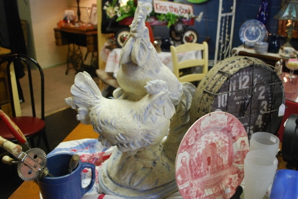 "This ""chippy"" concrete rooster and hen are actually from an old fountain, but we think they'd look tres fabu on the counter of a French Country kitchen!"
