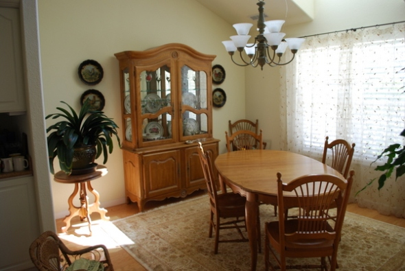 Lovely Ethan Allen Country French table w/6 chairs and china hutch.